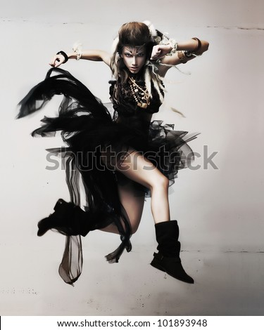 Emotional sexy Wild Woman with Flying hair and Old-fashioned waving Savage Clothes. Tribal Concept - stock photo