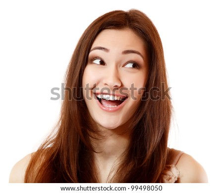 Emotional teen girl happy ecstatic ecstasy smiling and looking to right side. Isolated on white background. - stock photo