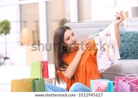 Emotional woman after successful shopping at home