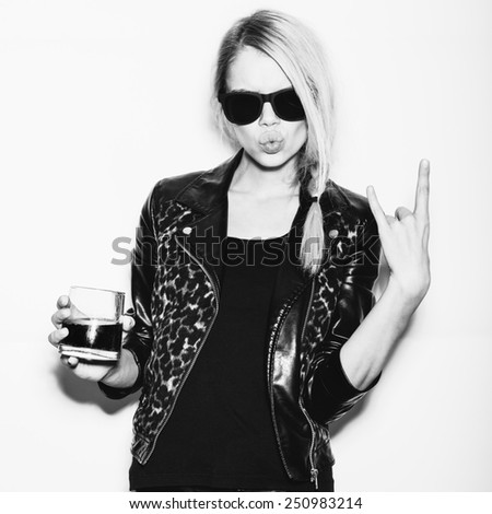 Emotional woman in sunglasses drinking alcohol cocktail. Toned. White background, not isolated - stock photo
