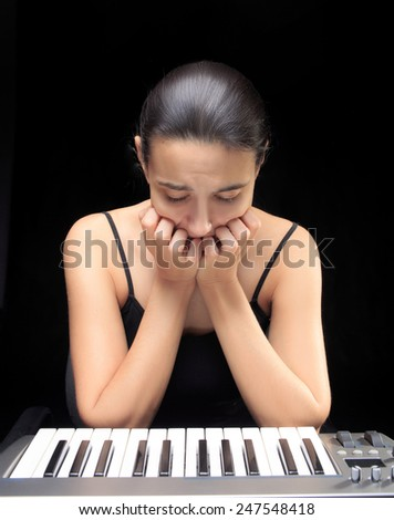emotional woman learning to play the piano.  - stock photo