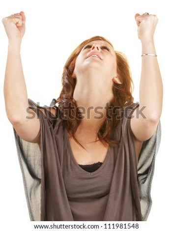 Emotional woman looking up with fists in the air - stock photo