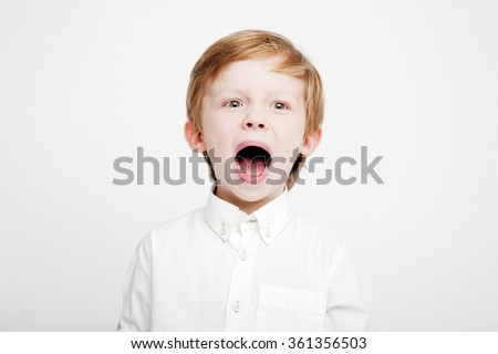 emotional young boy screaming