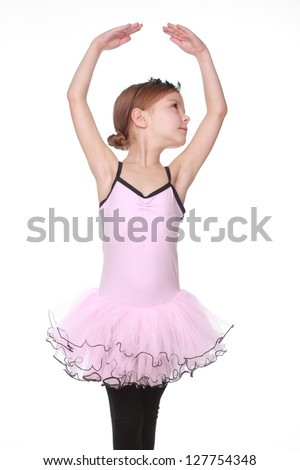 Emotional young girl dances in a ballet tutu - stock photo