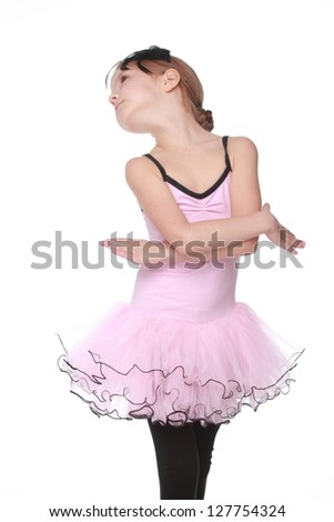 Emotional young girl dancing in a ballet tutu on white background - stock photo