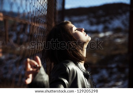 Emotional young woman portrait on urban blurry environment - stock photo