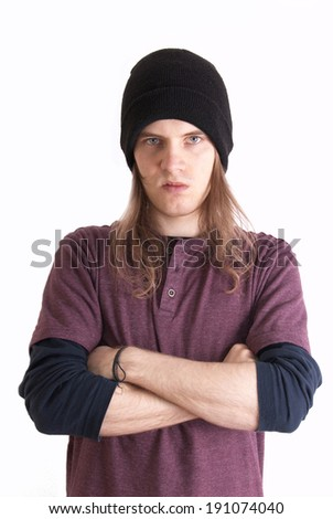 Emotions conceptual image. Angry rebellious teenager with long hair. - stock photo