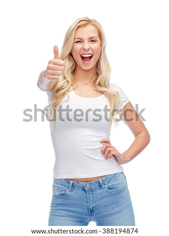 emotions, expressions, advertisement and people concept - happy smiling young woman or teenage girl in white t-shirt showing thumbs up - stock photo