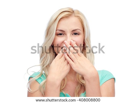 emotions, expressions, embarrassment and people concept - confused young woman or teenage girl wrinkling and closing her nose - stock photo