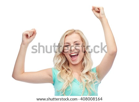 emotions, expressions, success and people concept - happy young woman or teenage girl celebrating victory - stock photo