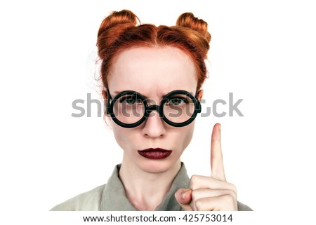 Emotions. Funny nerdy redhead girl. Beautiful girl in glasses.