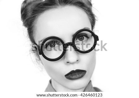 Emotions. Funny nerdy redhead girl. Beautiful girl in glasses.Black and white photo