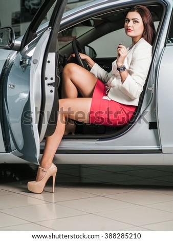 Emotions gestures. Closeup portrait, cheerful, joyful, smiling, beautiful business lady holding up keys to her first new business class car - stock photo