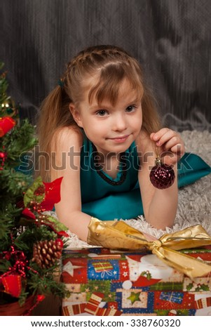 emotions of the nice girl with a New Year's gift  - stock photo