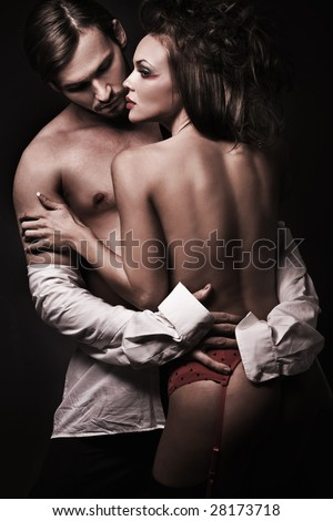 Emotive portrait of a sexy couple - stock photo