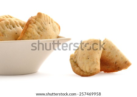Empanadas from South America : stuffed pastries made with corn flour and filled with meat or cheese - stock photo