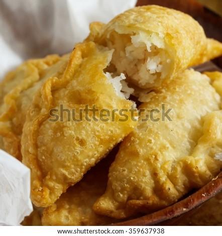 Empanadas with sweet coconut filling / Sweet Empanadas, selective focus - stock photo