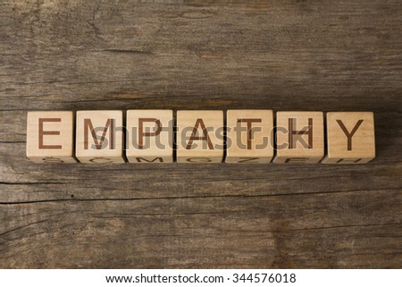 EMPATHY text on a wooden background