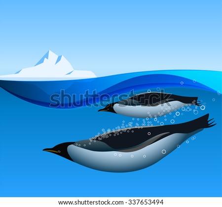 Emperor Penguins swim underwater in the Antarctic ocean with iceberg on the background - stock photo