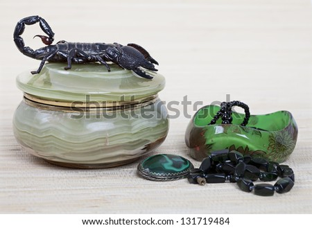 Emperor Scorpion on onyx jewelry box, malachite brooch and black necklace