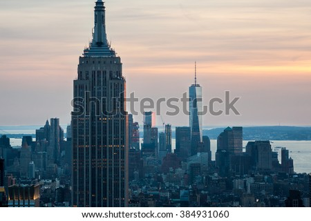Empire State Building and One world trade center in background at sunset, New york city skyline, view from Top of the rock Rockefeller center, Manhattan