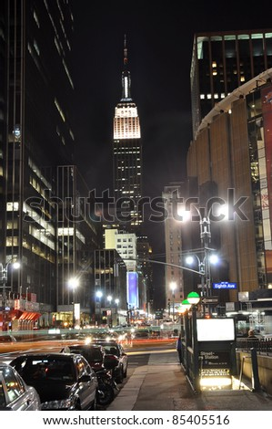 Empire State Building at night, photo taken near Madison Square Garden in New York, USA. - stock photo