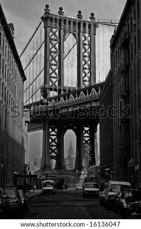 Empire State Building Through Manhattan Bridge - stock photo