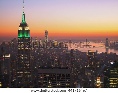 Empire States building and New York City at sunset