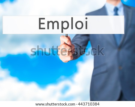 Emploi (Employment in French)  - Businessman hand holding sign. Business, technology, internet concept. Stock Photo