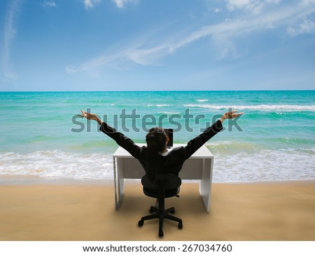 Employee are happy at work, she was reminded of her time to relax at the beach in the summer - stock photo