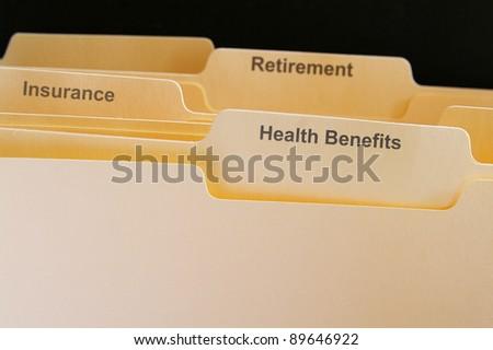employee benefits folders - stock photo