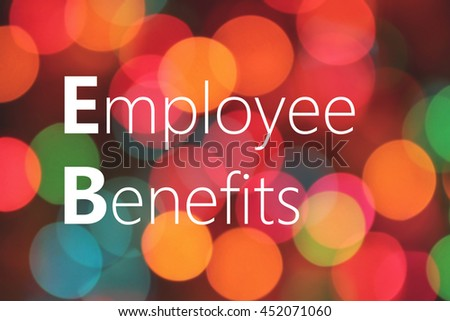 Employee Benefits text on colorful bokeh background - stock photo