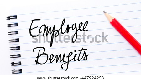 Employee Benefits written on notebook page with red pencil on the right
