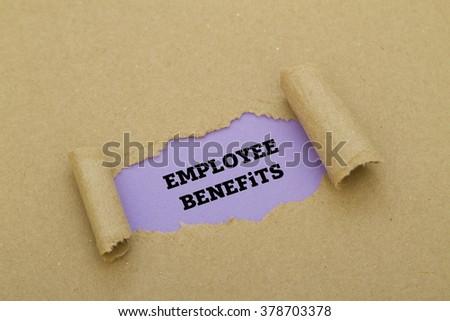Employee Benefits written under torn paper - stock photo