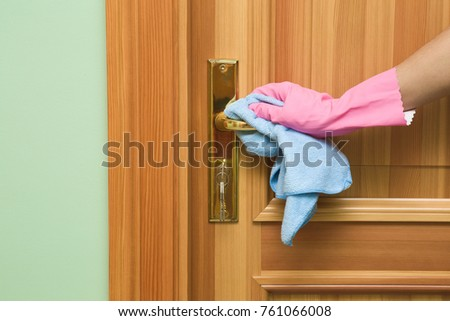 Employee hand in rubber protective glove with micro fiber cloth wiping a wooden door. Maid & Cloth Door Stock Images Royalty-Free Images u0026 Vectors | Shutterstock pezcame.com