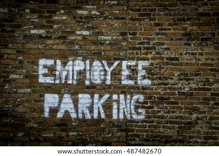 Employee Parking sign on brick wall in Augusta, Georgia.