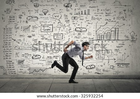 Employee running away from schemes and statistics - stock photo