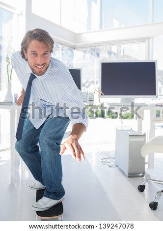 Employee skating through his office in a shirt and tie - stock photo
