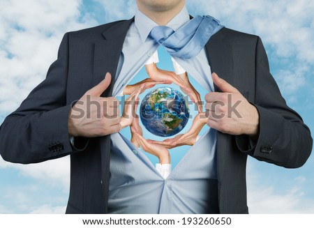 Employee tearing the shirt, hands holding the earth. Elements of this image furnished by NASA.