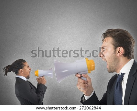 Employee tries to thwart his boss screaming - stock photo