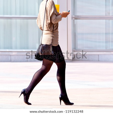 Employee walking on the background of the office. The modern woman. - stock photo