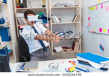 Employee watching movie on vr virtual reality glasses