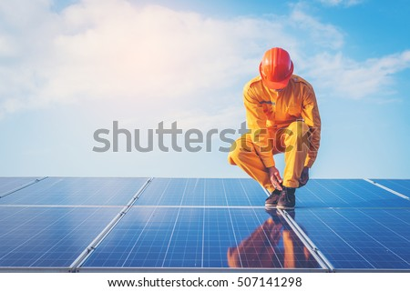 employee working on  maintenance equipment at industry solar power: working on Wrench tightening solar mounting structure of photovoltaic panel