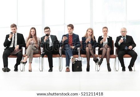 Employees carefully listening to their  boss at a business meeti