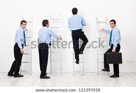 Employees climbing the corporate ladders competing with each other - stock photo