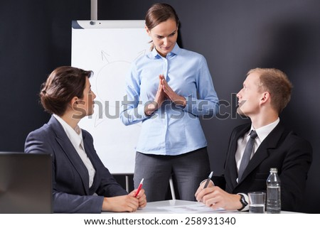 Employees having a meeting with boss, horizontal - stock photo