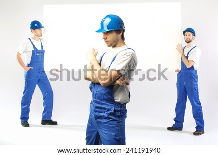 Employees holding white banner - stock photo