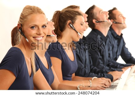 employees in a  call center - stock photo