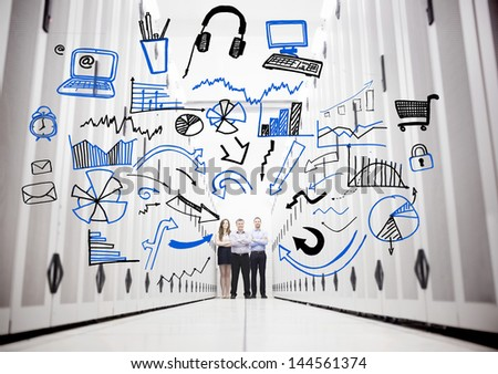Employees in a data center standing in front of drawings of charts and computer sketches - stock photo