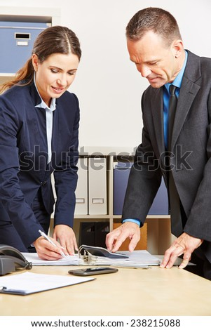 Employees of a bank doing financial calculation for a mortage - stock photo